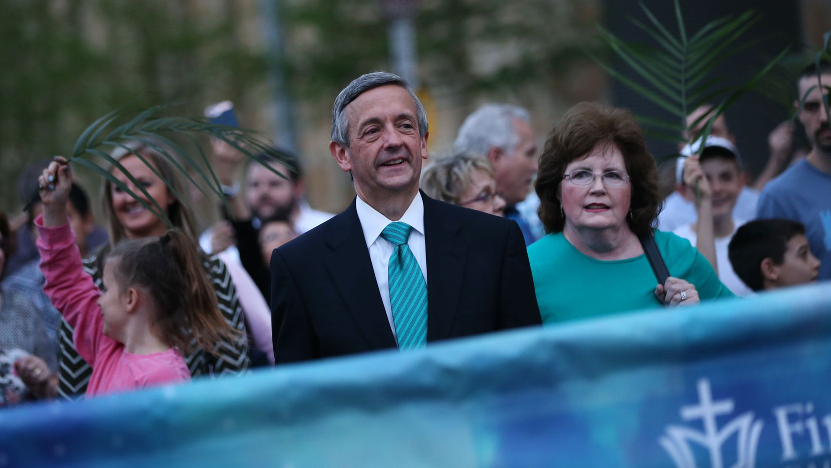 Pastor Robert Jeffress walks with his wife, Amy Jeffress, during the March for Eternal Life led by members of First Baptist Dallas in downtown Dallas on March 25.
