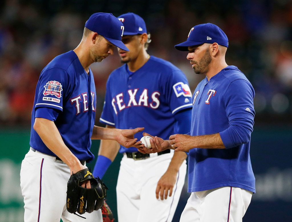 Texas Rangers manager Chris Woodward (8) pulls Texas Rangers starting pitcher Mike Minor (23) during the sixth inning of play at Globe Life Park in Arlington, Texas on Thursday, May 30, 2019. Texas Rangers lost to the Kansas City Royals 4-2. (Vernon Bryant/The Dallas Morning News)