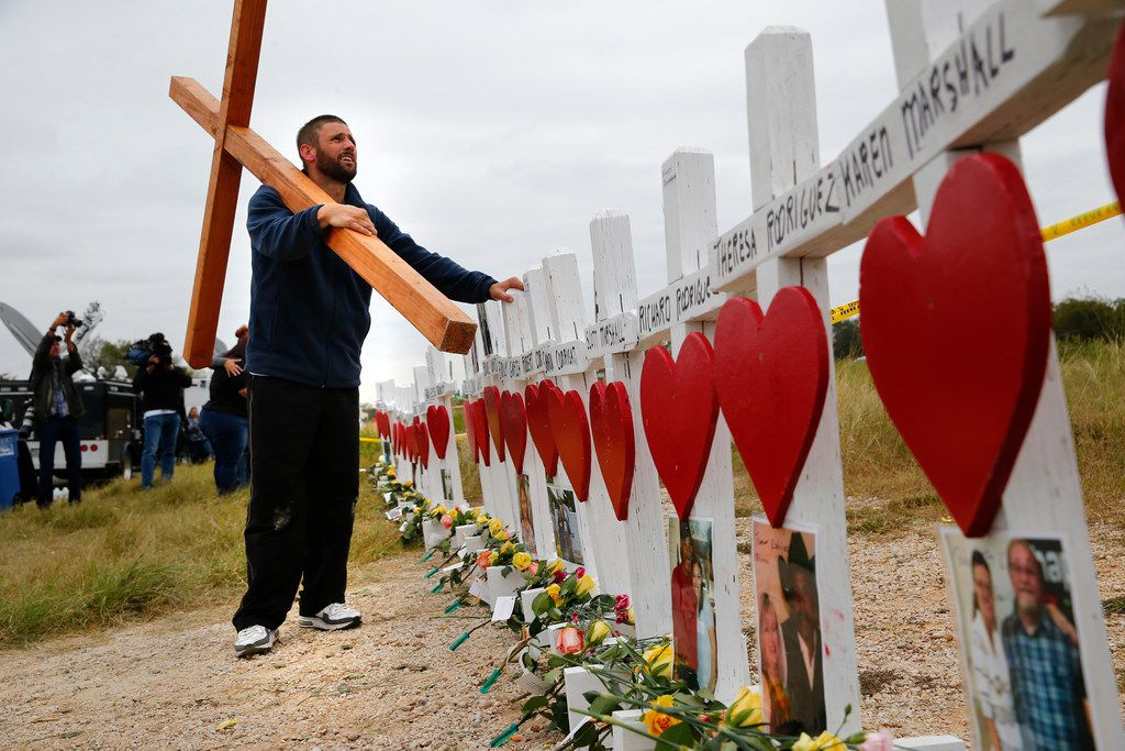 Joshua John from Roanoke, Va., with The Cross Love You Ministry ends the last leg of his 26-mile walk (one for each of the killed) to pray on the crosses at the memorial site next to the First Baptist Church in Sutherland Springs on Nov. 9, 2017.  The church was the site of a shooting that killed 26 worshippers and left 30 injured.