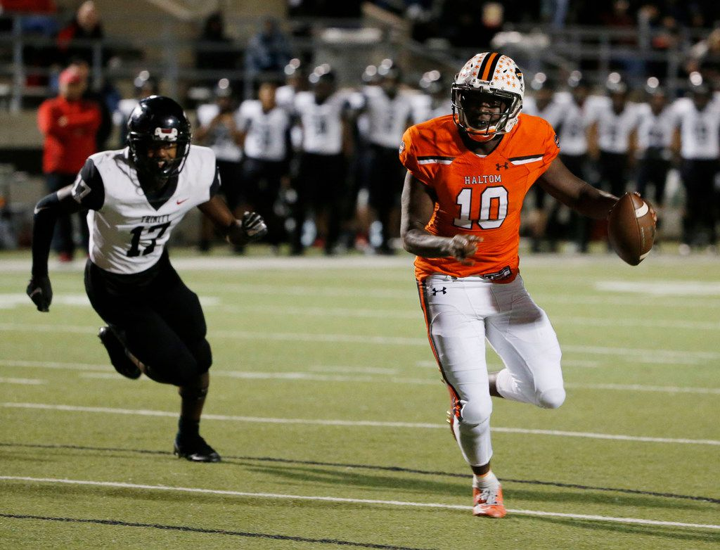 Haltom quarterback quarterback Adam Hill gets away from Trinity defender LD Martin (17) to score a touchdown during the first half of their high school football game on Oct. 11, 2019 in North Richland Hills. (Michael Ainsworth/Special Contributor)