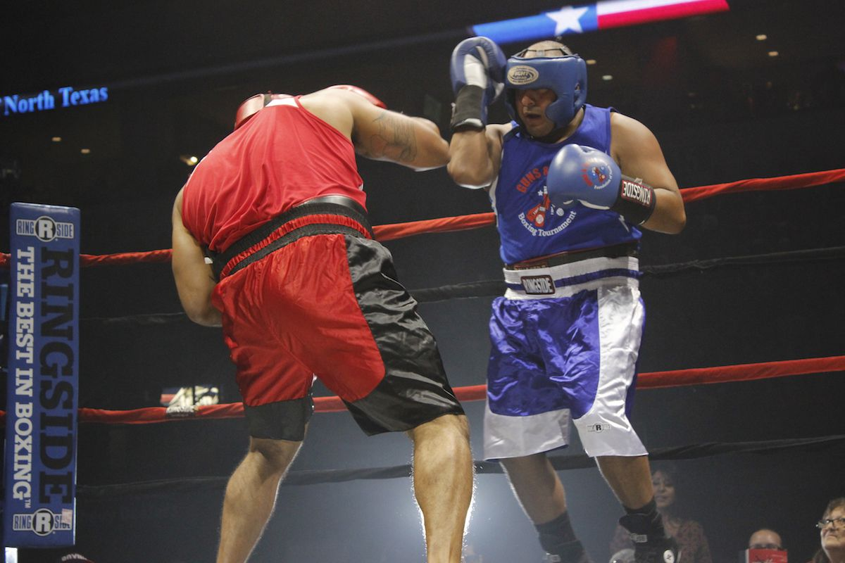 Dallas police Senior Cpl. Daniel Espinosa (right) went toe to toe with Dallas Fire-Rescue's Adrian Delgado on Saturday night at the 15th annual Guns and Hoses boxing tournament at the Allen Event Center. Espinosa narrowly defeated Delgado. Their bout was declared fight of the night.