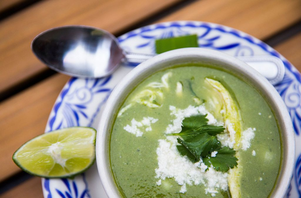 A bowl of pozole verde prepared by Chef Nico Sanchez at Mesa Maya