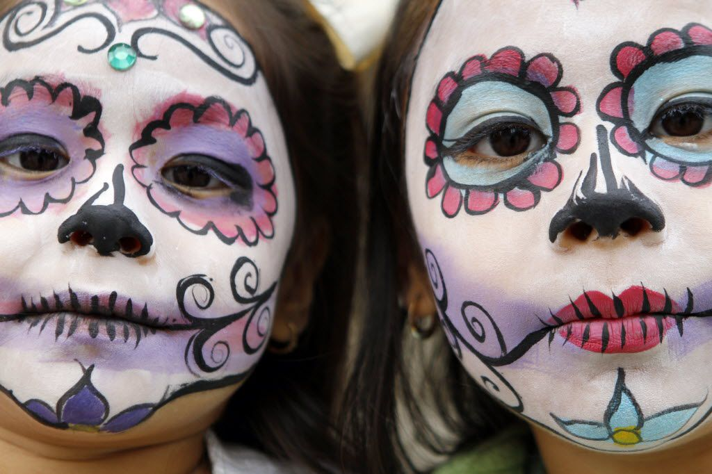 Sisters Cristal Ortega, 4 (left), and her sister Kenya Ortega, 7, show off their day of the dead face paint they received during the ArtLoveMagic Dia de los Muertos en Dallas event celebrating the Mexican holiday of Day of the Dead, on Sunday, Nov. 02, 2014 outside the Cathedral Shrine of the Virgin of Guadalupe in Downtown Dallas. Ben Torres/Special Contributor 11032014xMETRO