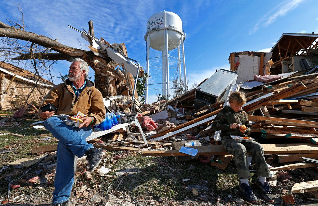 Homeowner Gary Hale (left) took a lunch break with his grandson Gabriel Hale while cleaning up at his house,  which was leveled by a tornado in Rowlett on Dec. 26, 2015.