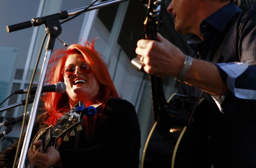 Wynonna Judd and her husband Cactus Moser perform during the red carpet event for the screening of The Hornet's Nest, on Monday, May 05, 2014 at the Angelika Film Center in Dallas.