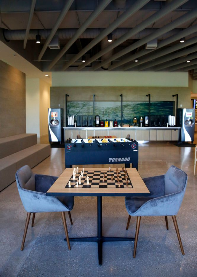 AmerisourceBergen's new 300-square-foot facility has a modern design and some features inspired by Texas, such as leather rocking chairs and an indoor fireplace. It has games in the dining area. (Rose Baca/Staff Photographer)