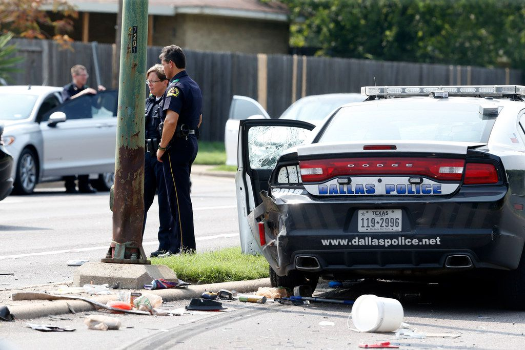 Two Dallas police officers were among those taken to hospitals after a fiery crash involving multiple vehicles on Marsh Lane in Dallas.