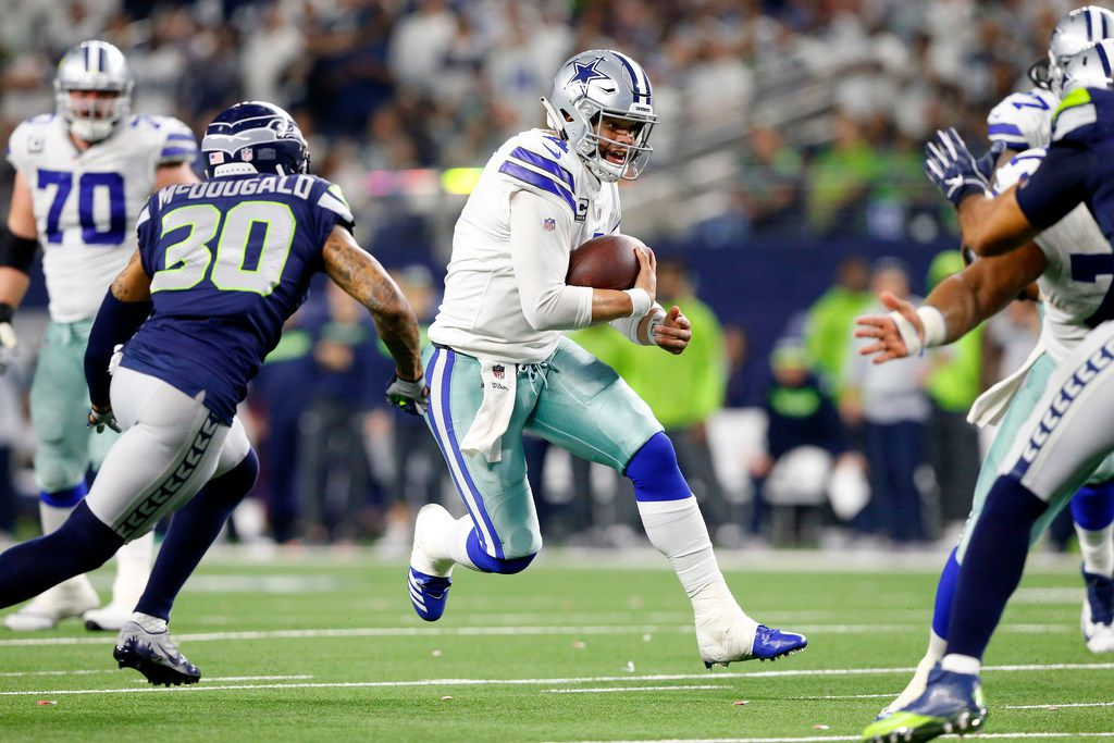 Dallas Cowboys quarterback Dak Prescott (4) runs for a would-be fourth quarter touchdown in their NFC Wild Card win over the Seattle Seahawks at AT&T Stadium in Arlington, Texas, Saturday, January 5, 2019. Dak came up short but ran in the touchdown a couple plays later. The Cowboys won, 24-22. (Tom Fox/The Dallas Morning News)