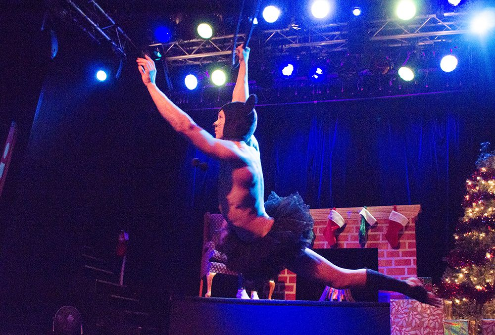 Skye Starling swings from an aerial ring during his performance.