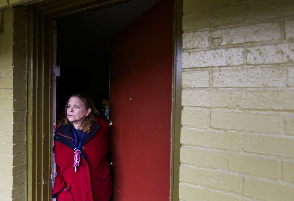 Marjorie McLin looks out the door of her home at Bryan Song Apartments, which she will have to leave within the month. Her apartment has no heat.