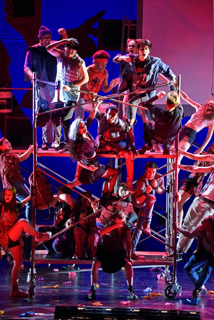 Actors stack rolling scaffolding in Junior Players' production of Green Day's American Idiot, directed by Valerie Hauss-Smith, at Moody Performance Hall.