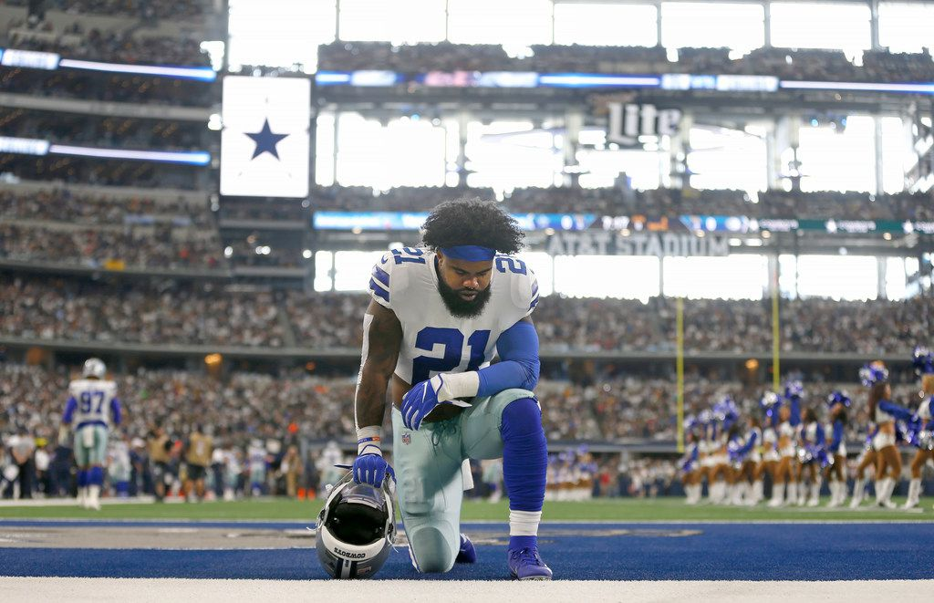 Dallas Cowboys running back Ezekiel Elliott (21) kneels in the end zone before the Green Bay Packers play the Dallas Cowboys in an NFL football game in Arlington, Texas, Sunday, Oct. 6, 2019. (AP Photo/Ron Jenkins)