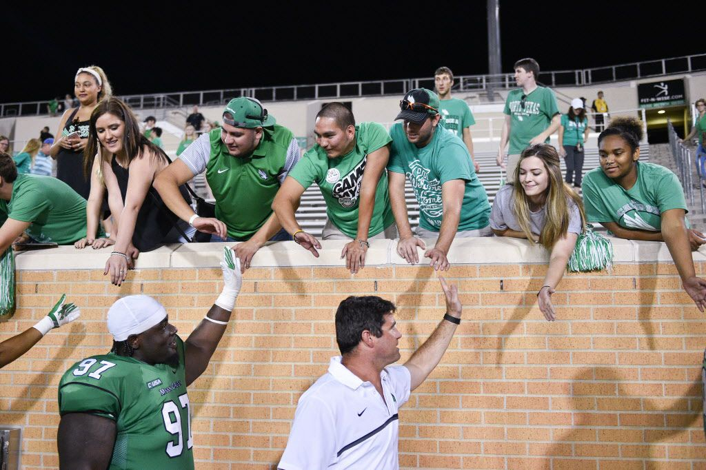 The North Texas fans congratulate the football team and head coach, Seth Littrell, on their victory at Apogee Stadium, Saturday, September 10, 2016, in Denton, Texas.  Jeff Woo/DRC