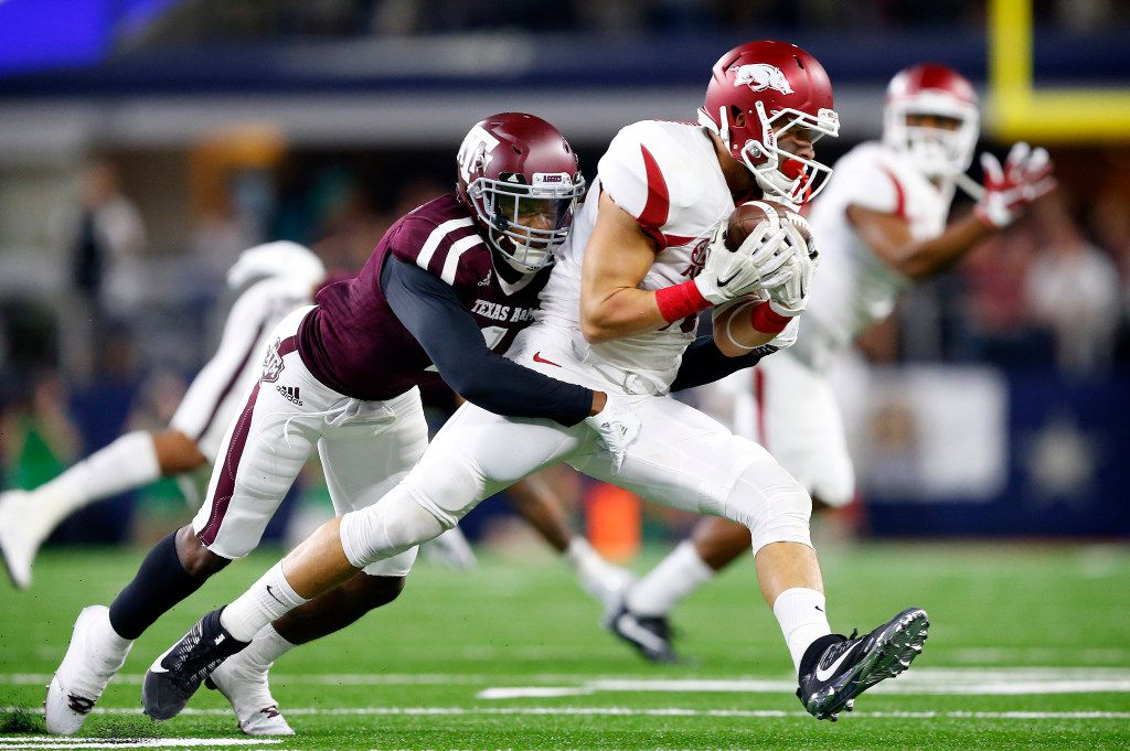 FILE - Arkansas Razorbacks wide receiver Drew Morgan (80) is tackled by Texas A&M Aggies defensive back Nick Harvey (1) after making a first quarter reception in the Southwest Classic at AT&T Stadium in Arlington, Texas, Saturday, September 24, 2016. (Tom Fox/The Dallas Morning News)