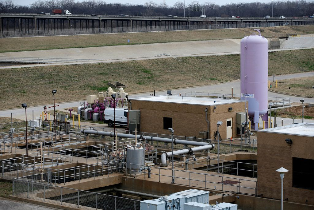 A pink tank holds treated water is pumped to a surrounding golf coarse at the Central Wastewater Treatment Plant in Dallas on Feb. 16, 2018.  (Nathan Hunsinger/The Dallas Morning News)