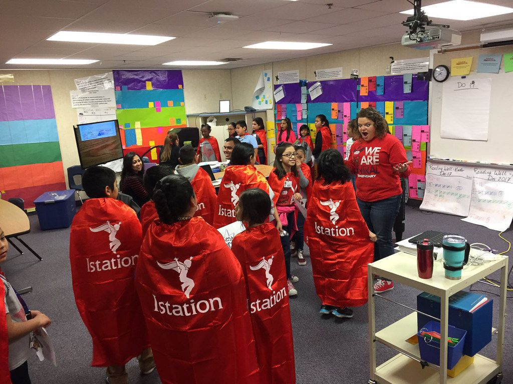 Lindsay Henderson, assistant principal and dean of instruction at Central Elementary in Lewisville ISD, gets her students excited about wearing their Istation red capes.