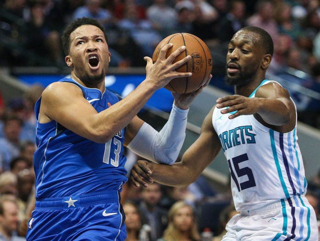 Dallas Mavericks guard Jalen Brunson (13) goes up for a shot past Charlotte Hornets guard Kemba Walker (15) during the first half a matchup between the Dallas Mavericks and the Charolette Hornets on Wednesday, Feb. 6, 2019 at the American Airlines Center in Dallas. (Ryan Michalesko/The Dallas Morning News)