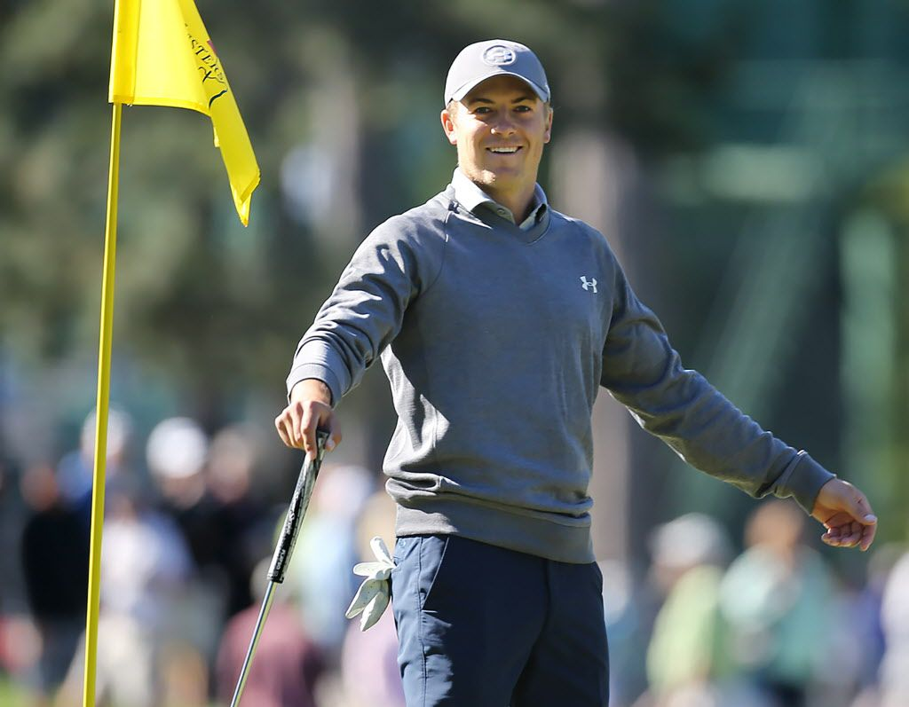 Masters defending champion Jordan Spieth smiles while putting on the third hole during a practice round for the Masters golf tournament in Augusta, Ga. Tuesday, April 5, 2016. (Curtis Compton/Atlanta Journal-Constitution via AP)
