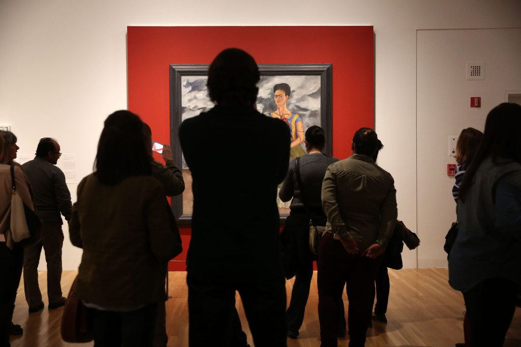 "A crowd gathers to look at ""The Two Fridas"" by Frida Kahlo in the ""Mexico 1900-1950: Diego Rivera, Frida Kahlo, Jose Clemente Orozco, and the Avant-Garde"" exhibit at the Dallas Museum of Art in Dallas on Tuesday, March 14, 2017. (Rose Baca/The Dallas Morning News)"