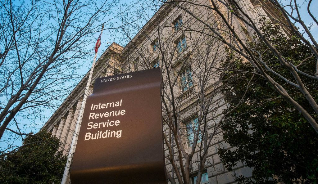 FILE - This April 13, 2014, file photo shows the Internal Revenue Service (IRS) headquarters building in Washington. President Donald Trump's plan to provide massive tax breaks to corporations faces big challenges as Washington struggles with mounting debt and the populist president tries to make good on promises to bring jobs and prosperity to the middle class. (AP Photo/J. David Ake, File)
