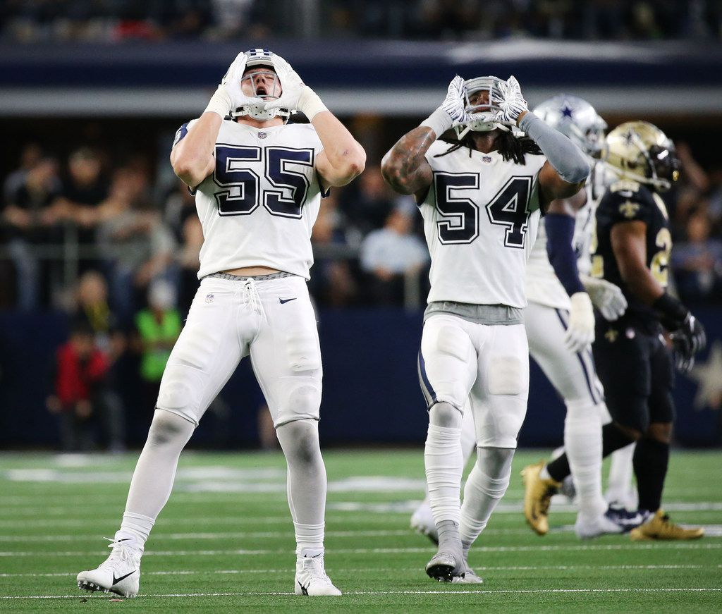 Dallas Cowboys outside linebacker Leighton Vander Esch (55) and Dallas Cowboys middle linebacker Jaylon Smith (54) celebrate after a tackle in the fourth period at AT&T Stadium in Arlington, Texas on Thursday, Nov. 29, 2018. The Dallas Cowboys beat the New Orleans Saints 13-10. (Rose Baca/The Dallas Morning News)