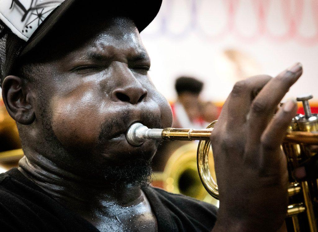 Erik Hickson plays the trumpet during practice.