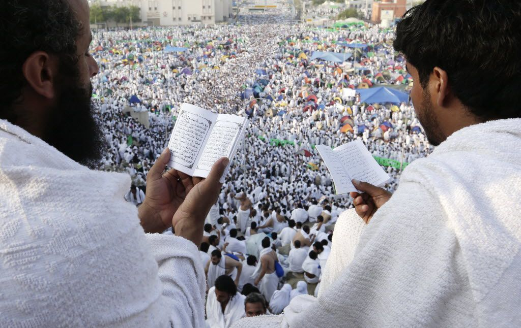 Muslim pilgrims pray on a rocky hill called the Mountain of Mercy on the Plain of Arafat near the holy city of Mecca, Saudi Arabia. Each year, millions of pilgrims visit the holy cities of Mecca and Medina for the pilgrimage.