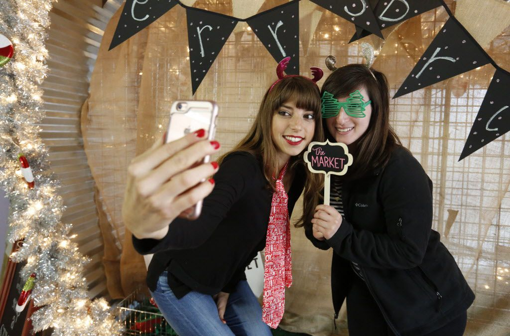 Nicole Shefik, left, and Layla Finch stop by the selfie station at The Market's soft opening at the Dallas Farmers Market Friday December 11, 2015.  (Ron Baselice/The Dallas Morning News)   [ This is located in the building formerly called Shed 2 at the Dallas Farmers Market ]