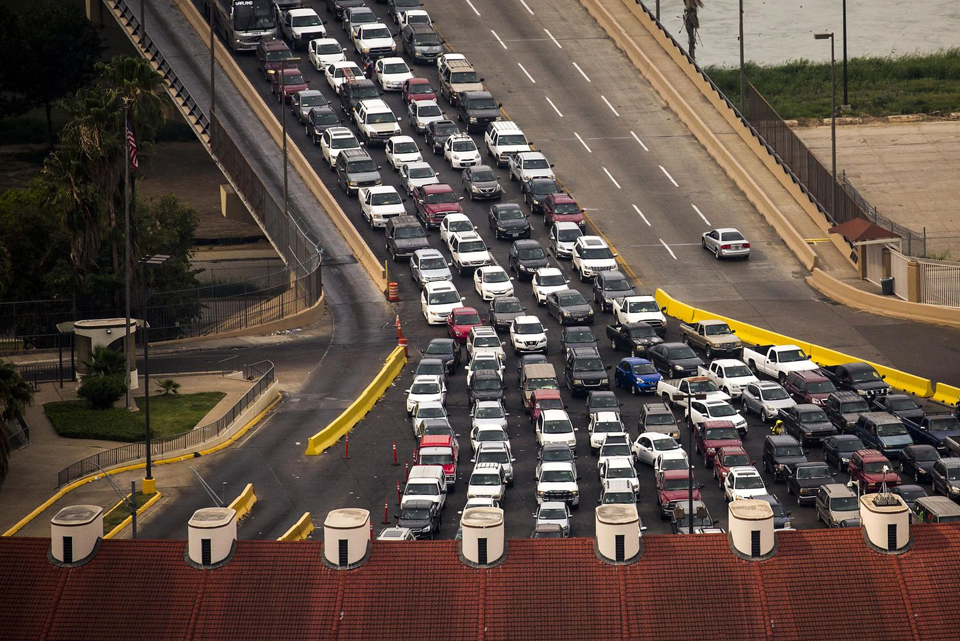 Vehicles wait on the Juarez-Lincoln International Bridge to enter the United States from Mexico on May 11, 2017, in Laredo, Texas.