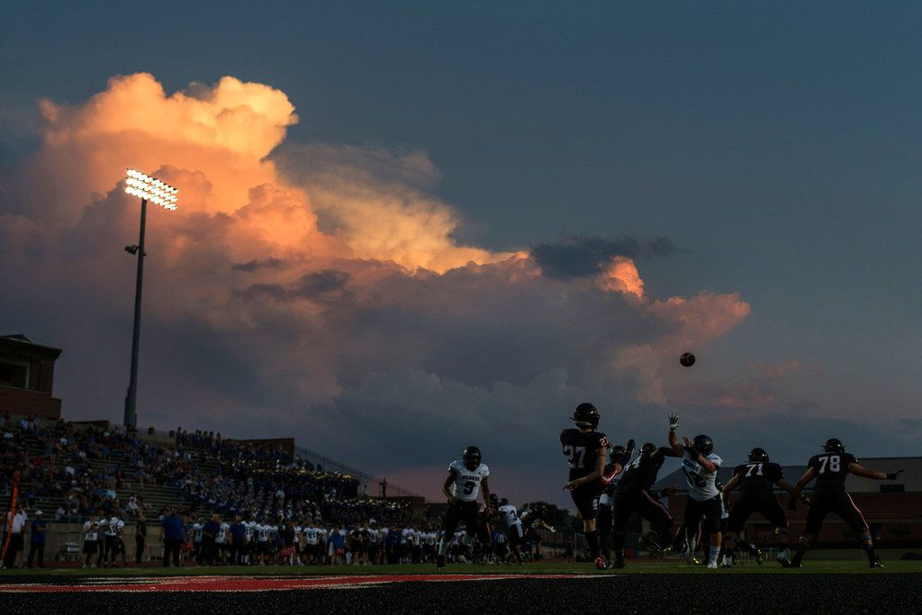 Coppell punter Tyler Reid punts into the evening sky during the first half of a high school football game against Hebron on Friday, Oct. 4, 2019, in Coppell, Texas. (Smiley N. Pool/The Dallas Morning News)