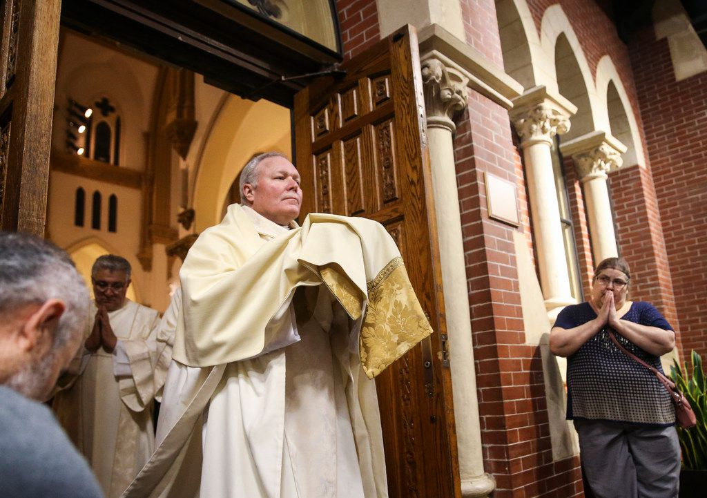 Bishop Edward Burns processes with the eucharist during a Mass of the Lord's Supper at Cathedral Shrine of the Virgin of Guadalupe on Thursday April 18, 2019 in Dallas. (Ryan Michalesko/The Dallas Morning News)