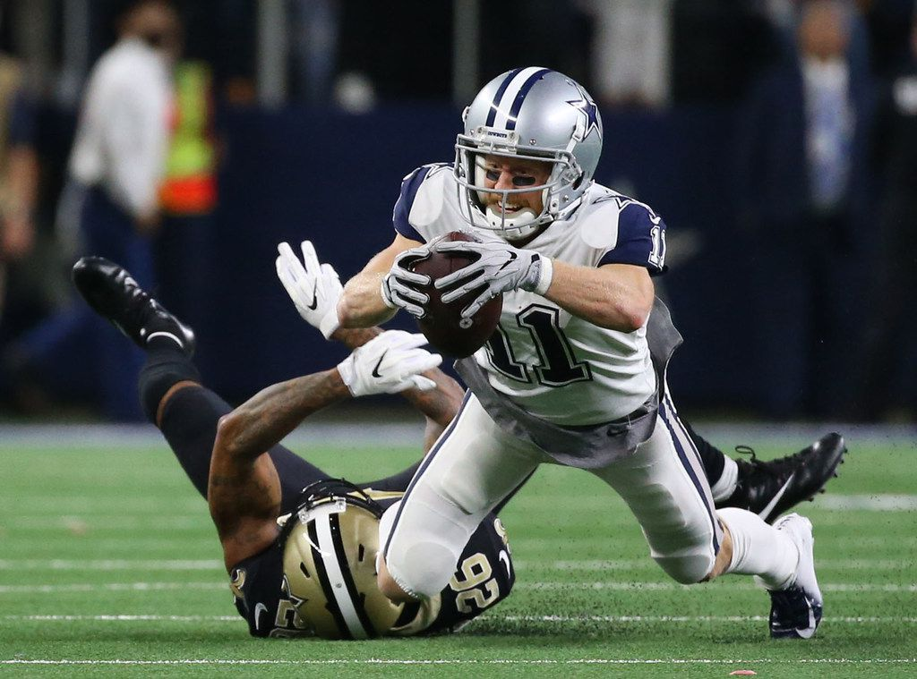 Dallas Cowboys wide receiver Cole Beasley (11) jumps for extra yardage against New Orleans Saints cornerback P.J. Williams (26) in the fourth period at AT&T Stadium in Arlington, Texas on Thursday, Nov. 29, 2018. The Dallas Cowboys beat the New Orleans Saints 13-10. (Rose Baca/The Dallas Morning News)