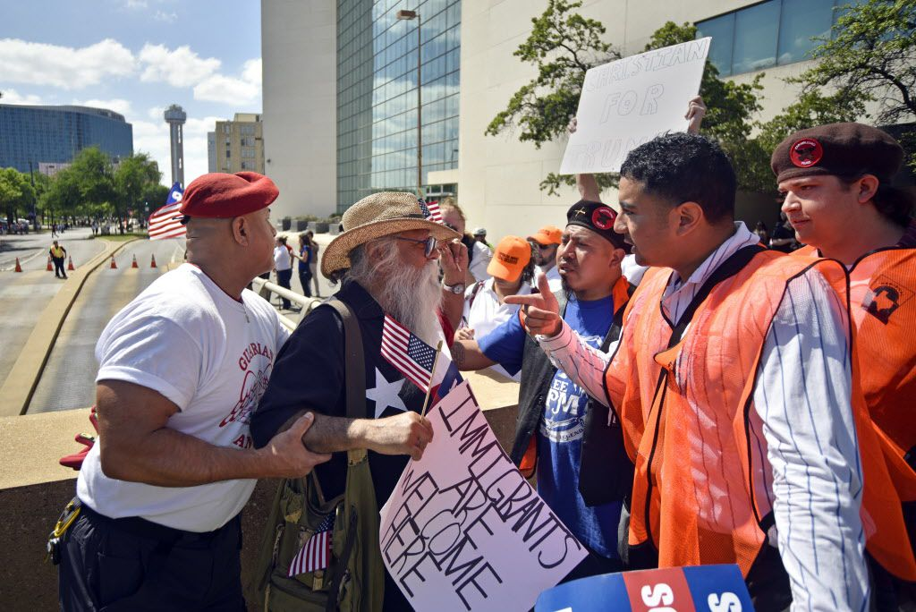 A man with the Guardian Angels safety patrol pulls Casa Gaytan, left, as he argued with a President Trump supporter during the Mega March for immigration rights in downtown Dallas, Sunday, April 9, 2017.