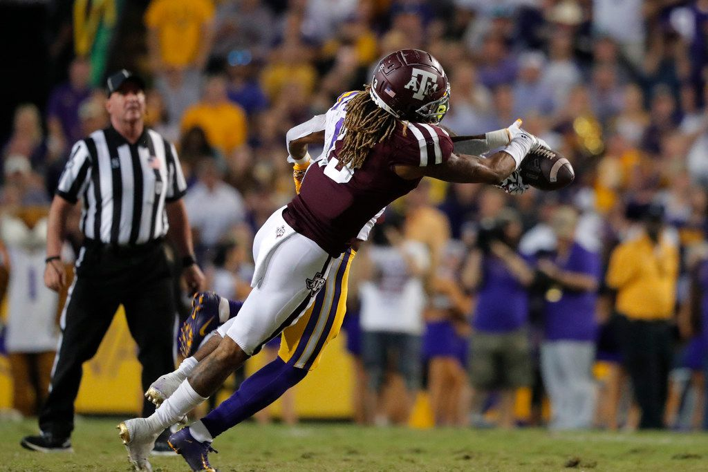 Texas A&M wide receiver Kendrick Rogers (13) tries to pull in a pass as he is defended by LSU cornerback Kristian Fulton during the second half of an NCAA college football game in Baton Rouge, La., Saturday, Nov. 30, 2019. LSU won 50-7. (AP Photo/Gerald Herbert)