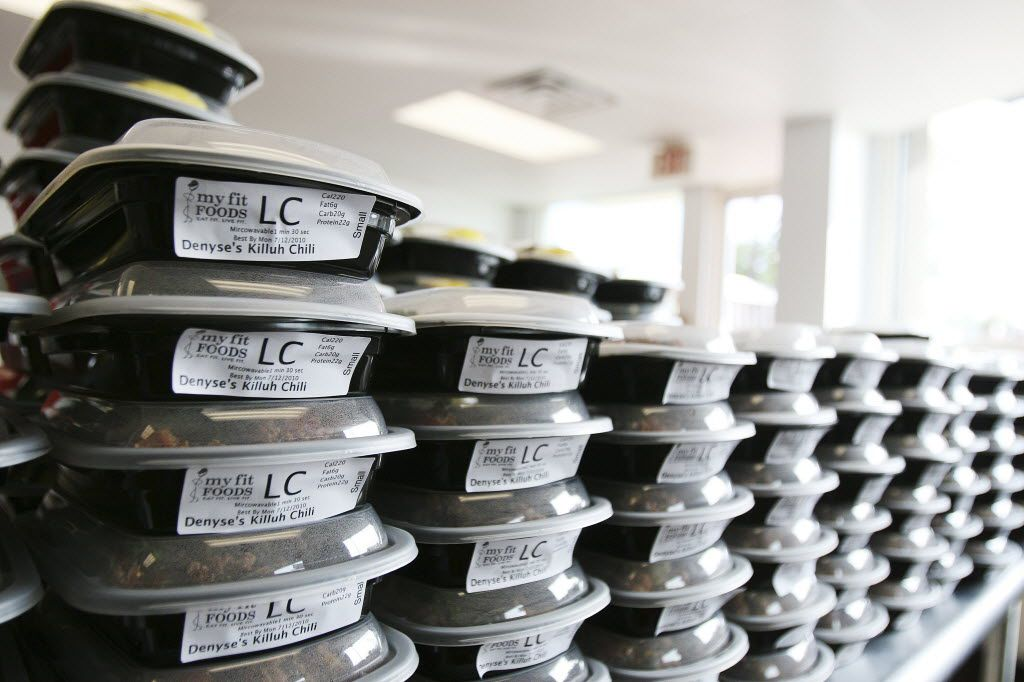 My Fit Foods meals stacked in refrigerated cases at the store in Dallas on Lemmon Ave. The Austin-based retailer has closed all its stores. (DMN File Photo)