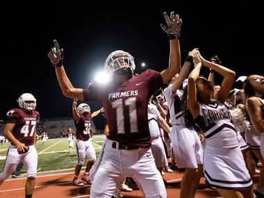 Lewisville senior Conner Jorgenson (11) celebrates his team's 41-16 victory over McKinney Boyd with cheerleaders and fans after a high school football game on Friday, September 13, 2019 at Max Goldsmith Stadium in Lewisville. (Jeffrey McWhorter/Special Contributor)