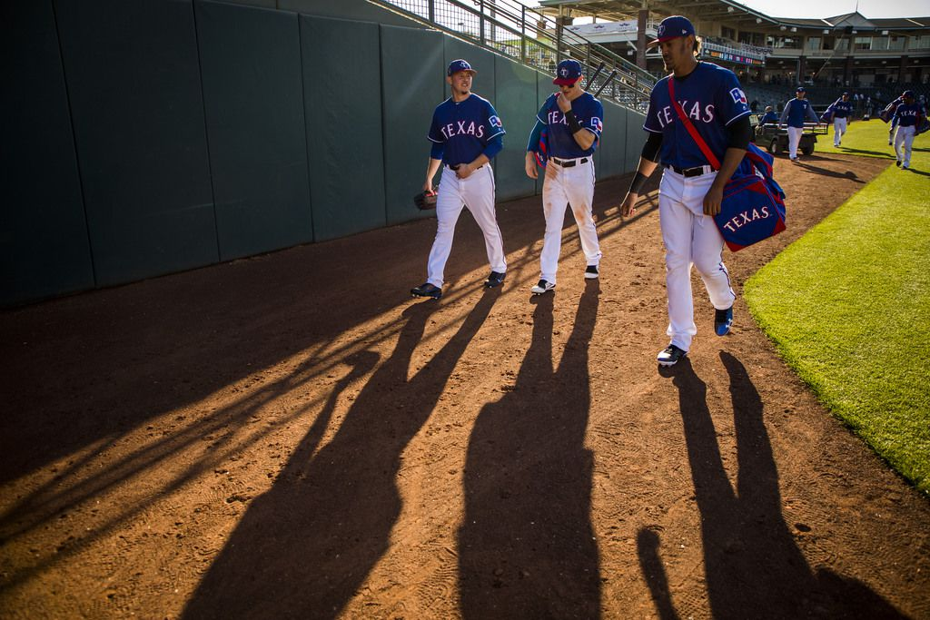 04:33 PM -- Robinson (center) walks off the field with pitcher Nick Gardewine (left) and first baseman Ronald Guzman after a 9-6 loss to the Los Angeles Dodgers.