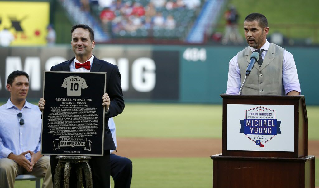 Michael Young (right) speaks after being inducted as a new member of the Rangers Baseball Hall of Fame at Globe Life Park in Arlington, Texas, Saturday, July 30, 2016. (Jae S. Lee/The Dallas Morning News)