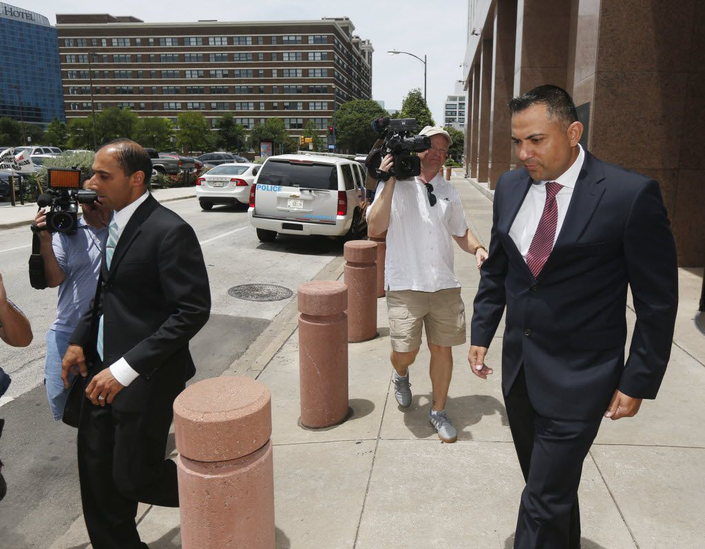 Christian Lloyd Campbell (right), a co-defendant in the federal corruption case against Dallas County Commissioner John Wiley Price, leaves the Earl Cabell Federal Building in Dallas on July 1, 2015.