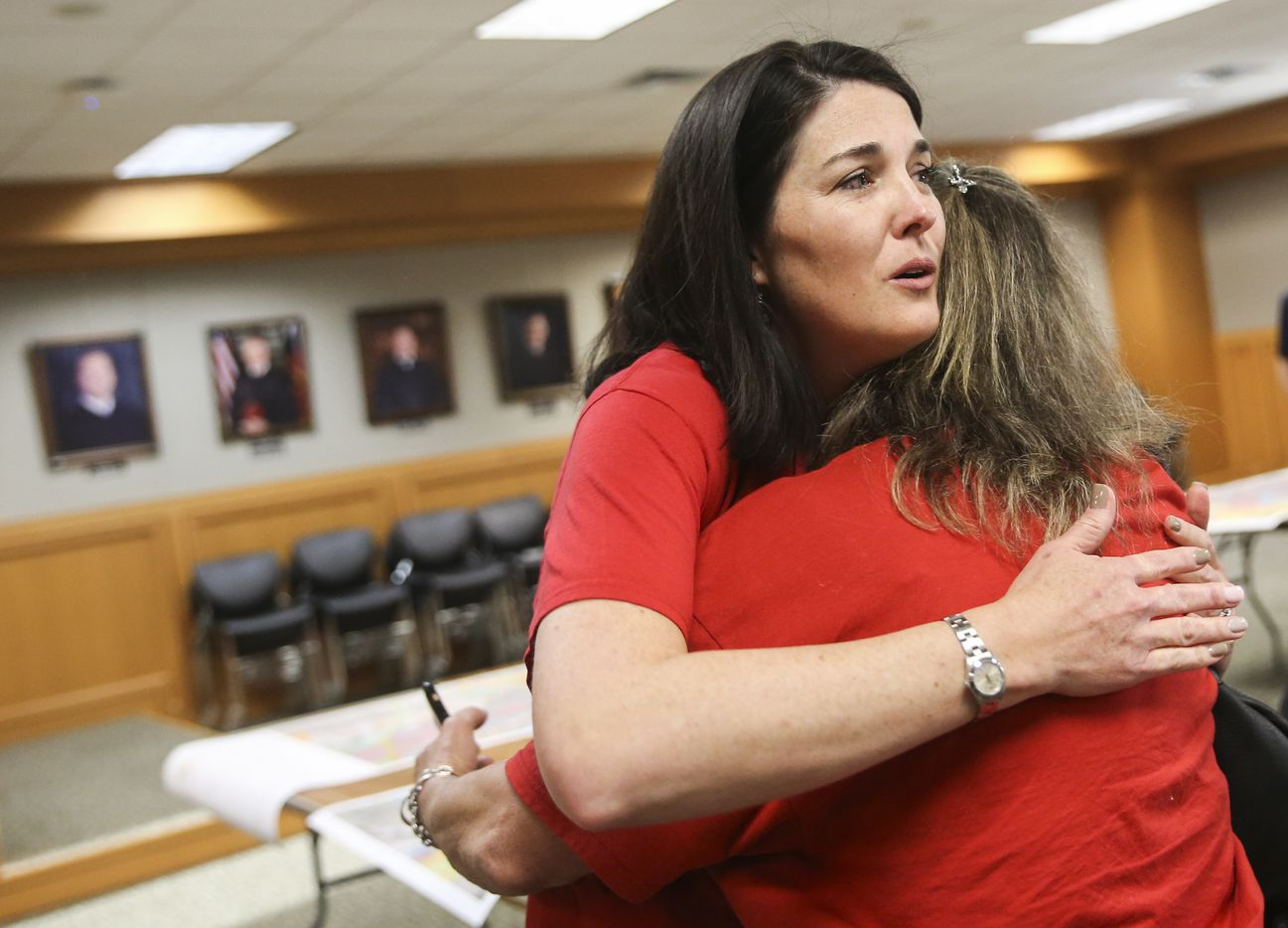 Tara Voigt, left, whose property will be affected by the new U.S. 380 alignment, embraces her friend, Lori Swim, who would be affected by one of the proposed bypass routes, during a Texas Department of Transportation open house to display new U.S. 380 alignment maps Thursday, March 21, 2019 at the Russell A. Steindam Courts Building in McKinney.