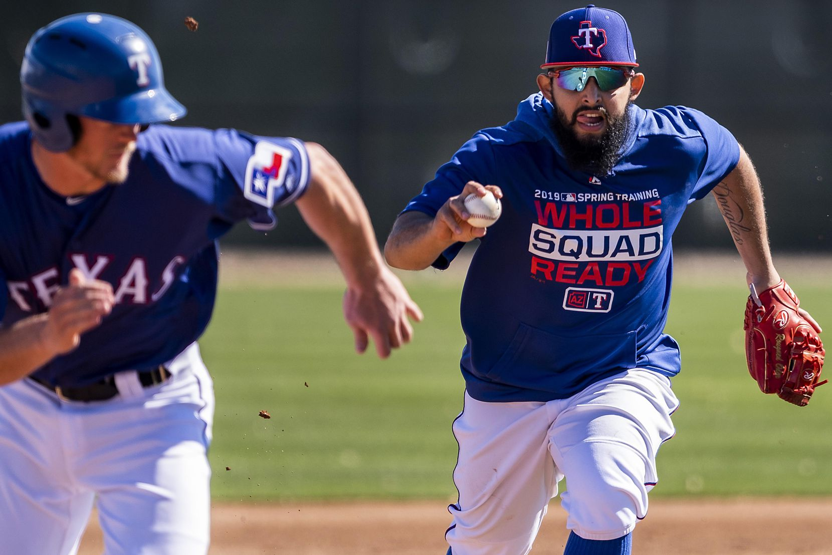 Texas Rangers second baseman Rougned Odor chases down minor-leaguer Alex Kowalczyk during a fielding drill on Feb. 19 at the team's spring training facility in Surprise, Ariz.