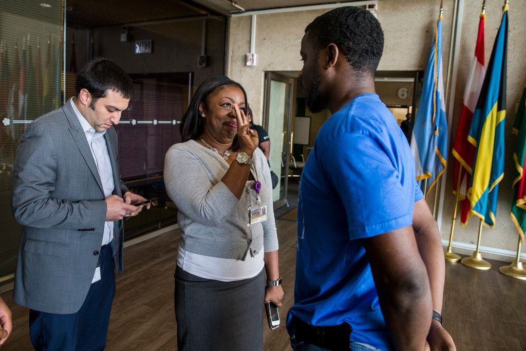 Chief of Community Relations Vana Hammond spoke with  activists Dominique Alexander during Wednesday's  Dallas City Council meeting.