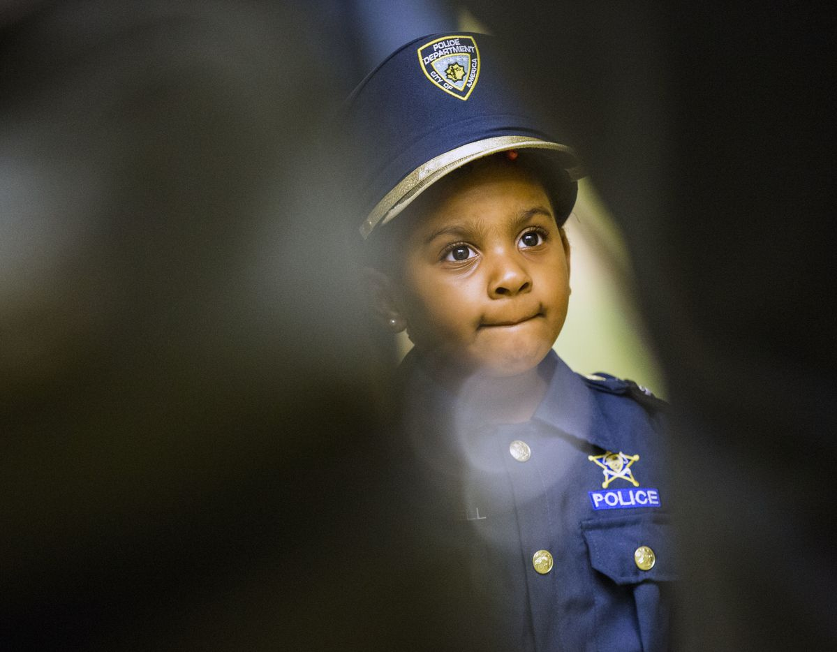 Four-year-old Ah'Maya Terrell tours the Cedar Hill Police Department with officers.