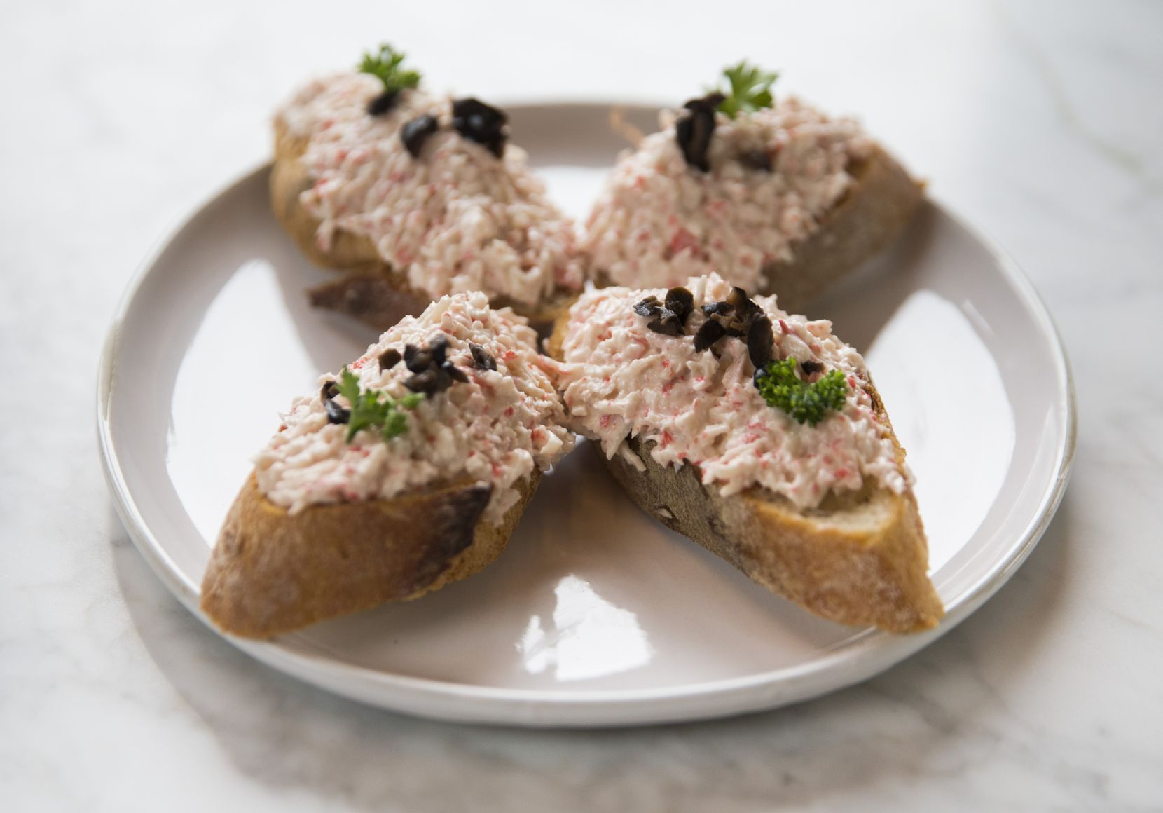 """""""Txaka,"""" or imitation crab salad on baguette slices, at Sketches of Spain"""