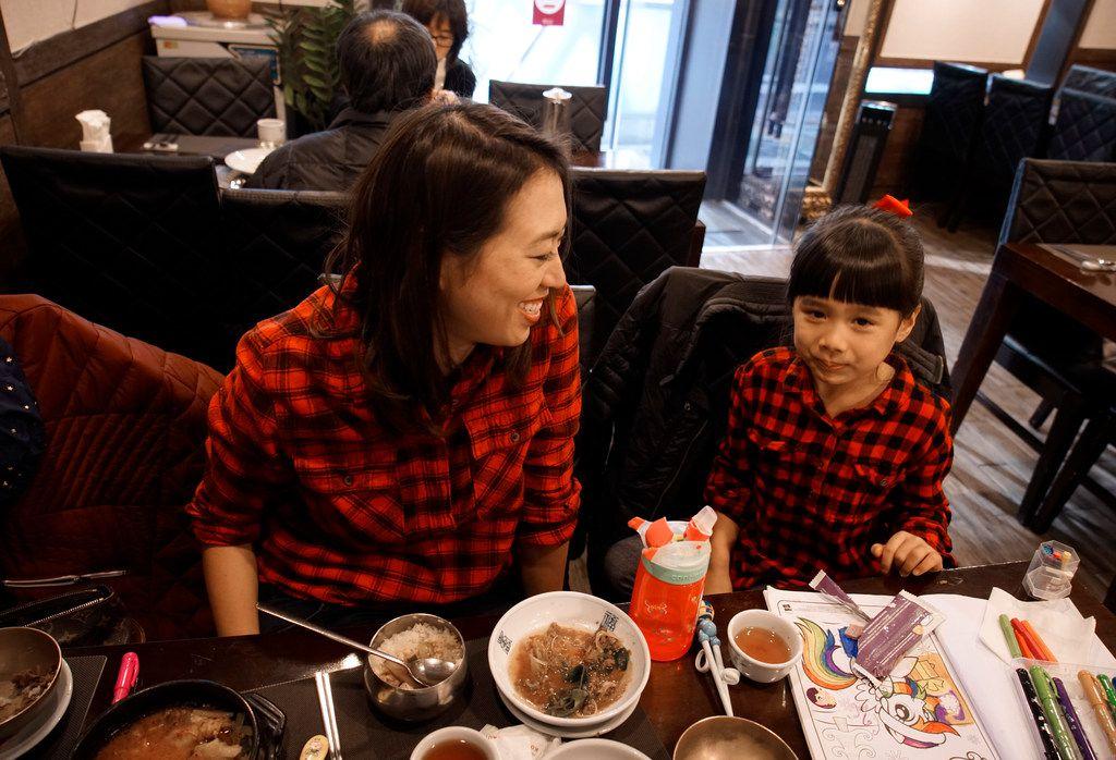 Elise Hu, NPR reporter, eats dinner with her daughter, Eva, 5.