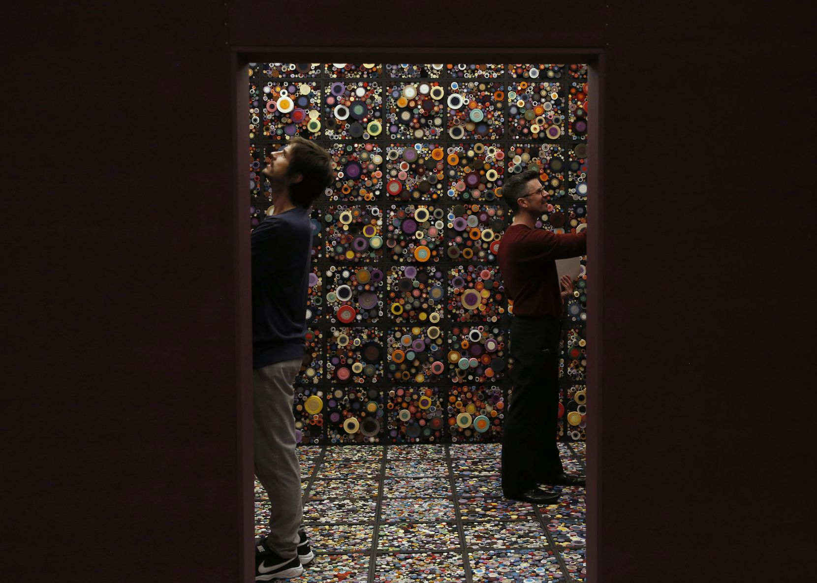 """The artists William Ladd (left) and Steven Ladd (right) stand inside their work """"Scroll Space"""" at """"Speechless: Different by Design"""" at the Dallas Museum of Art on Tuesday, Nov. 5, 2019."""
