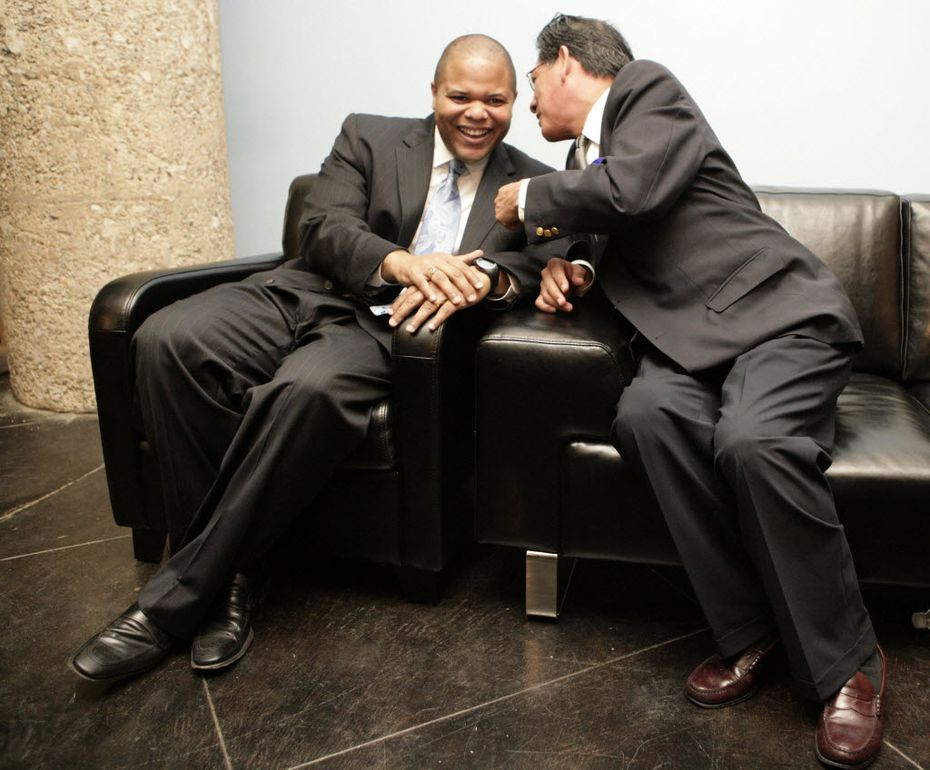 In this 2010 photo, Rep. Eric Johnson, D-Dallas, was still just an office hopeful when shares a moment with Rep. Roberto Alonzo (right) after a press conference where Johnson got endorsements from several Democratic officials at South Side on Lamar in Dallas.