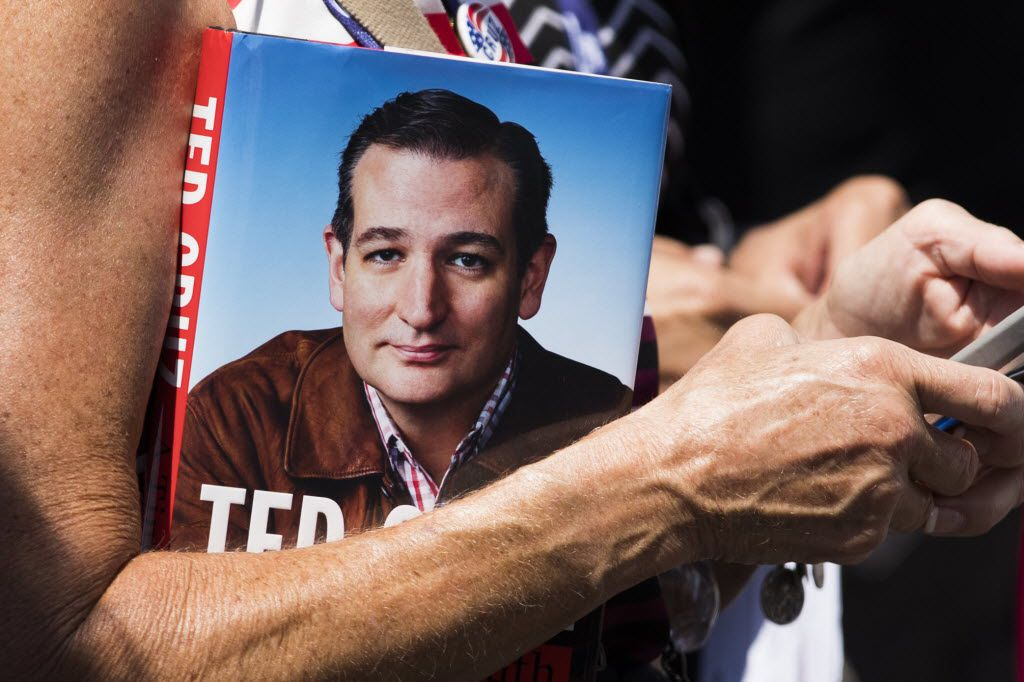 """A supporters holds a copy of his book while waiting in line for the doors to open for a Ted Cruz """"thank you"""" event on the third day of the Republican National Convention on Wednesday, July 20, 2016, in Cleveland. (Smiley N. Pool/The Dallas Morning News)"""