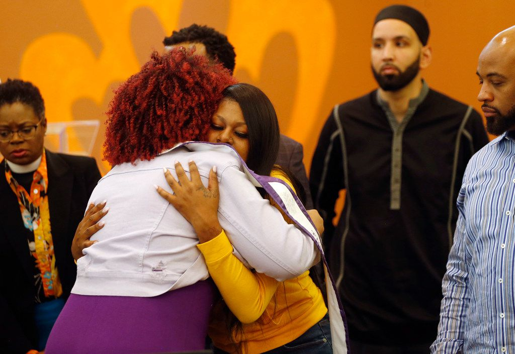 Dr. Irie Session (left) of Dallas hugs L'Daijohnique Lee (right) during a press conference denouncing violence against women at the Joy Empowerment Center in Dallas on Tuesday, March 26, 2019.