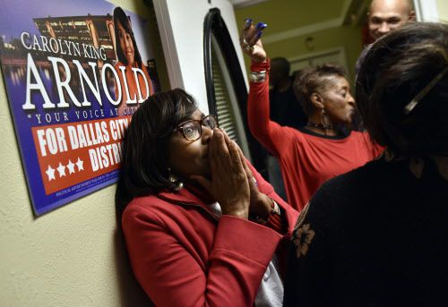 Candidate Carolyn King Arnold reacts with a surprised look as she's announced the winner of the Dallas City Council District 4 runoff between Keyaira Saunders, Tuesday evening Dec. 11, 2018 at Arnold's headquarters in Dallas. At right is supporter Bobbie McGee. Ben Torres/Special Contributor